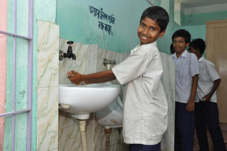 Children are using hand washing basin before and after nid-day meal - Copy